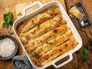 Солени палачинки с плънка (пълнеж) от кайма и доматен сос, запечени със сос бешамел и кашкавал на фурна